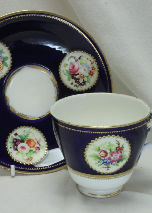 Royal Worcester hand painted cup and saucer