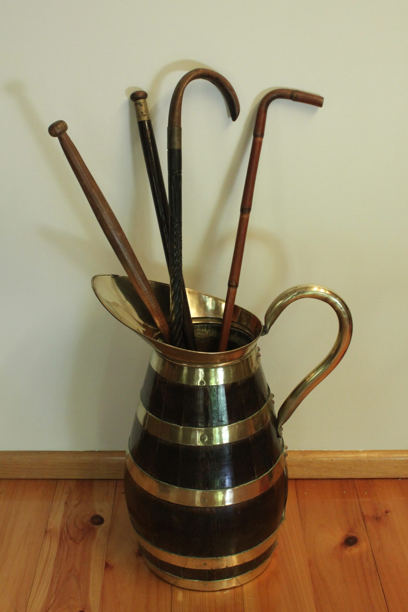 Oak brass bound stick or umbrella stand in the shape of a jug