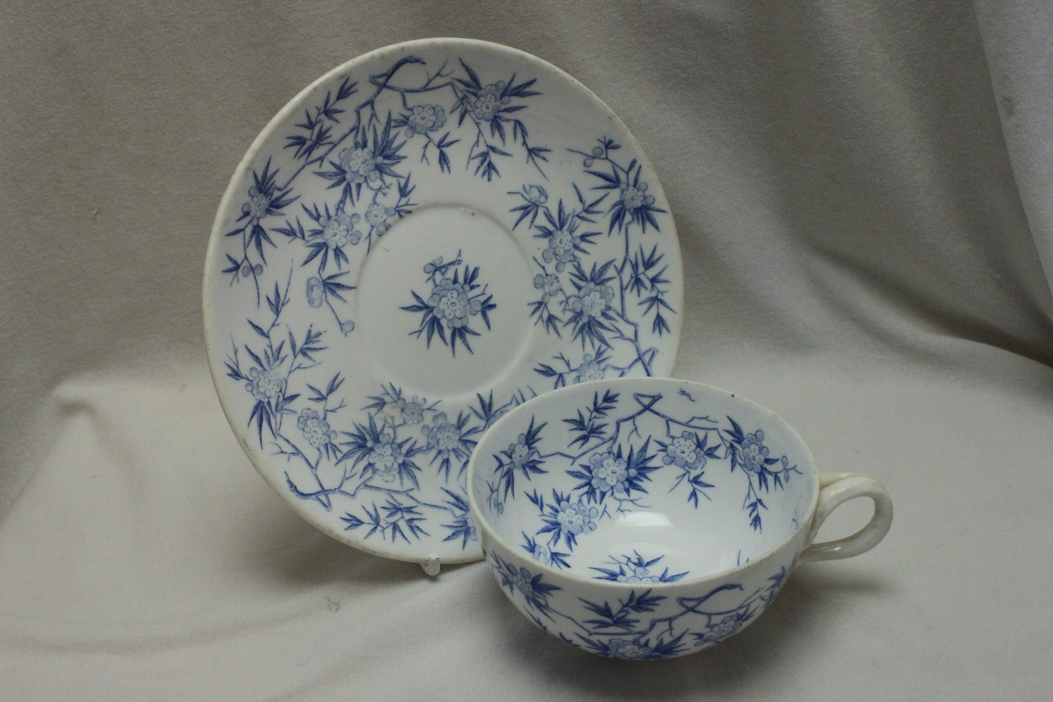 Sarreguemines blue and white porcelain cup and saucer