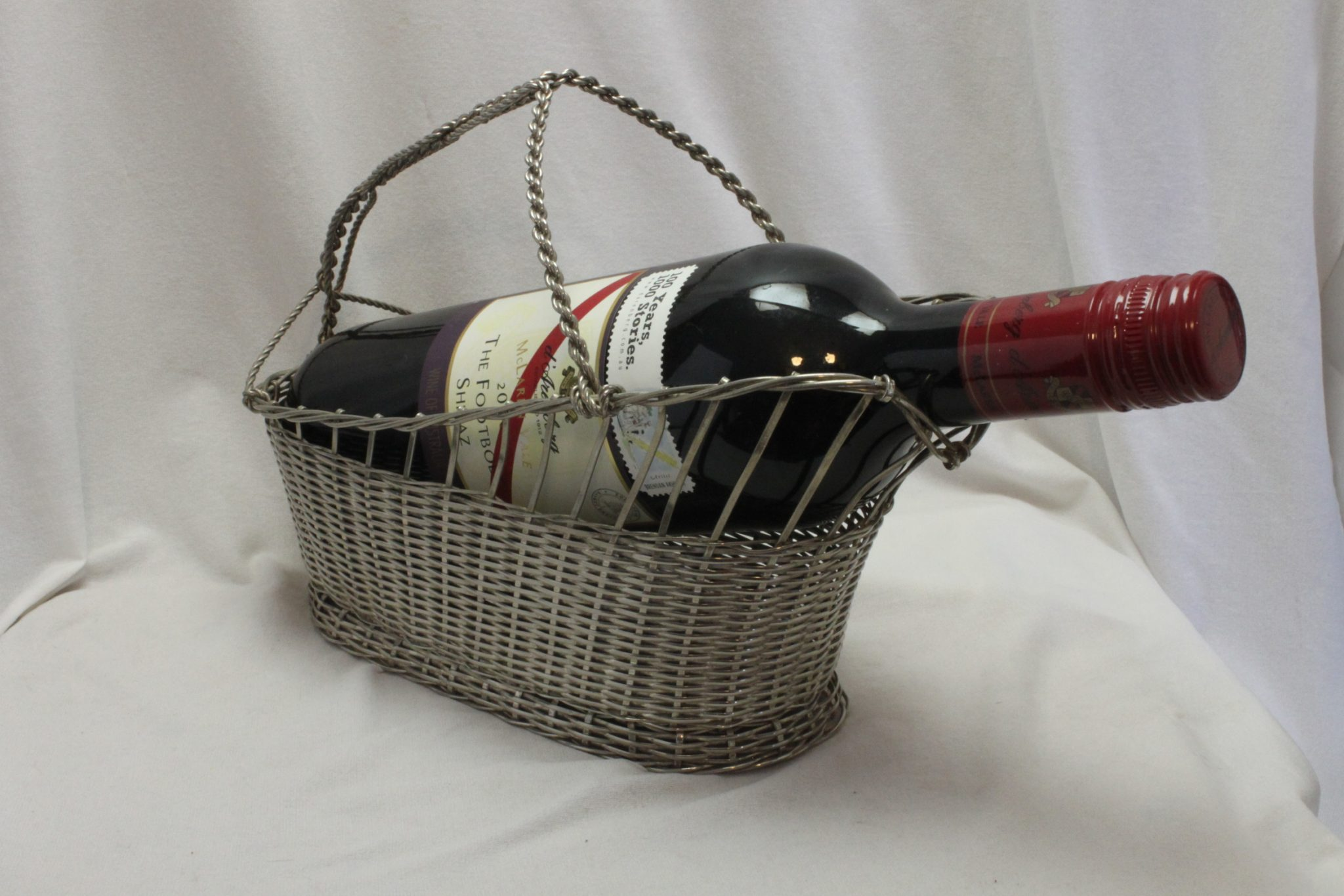 Silver plated wine bottle basket