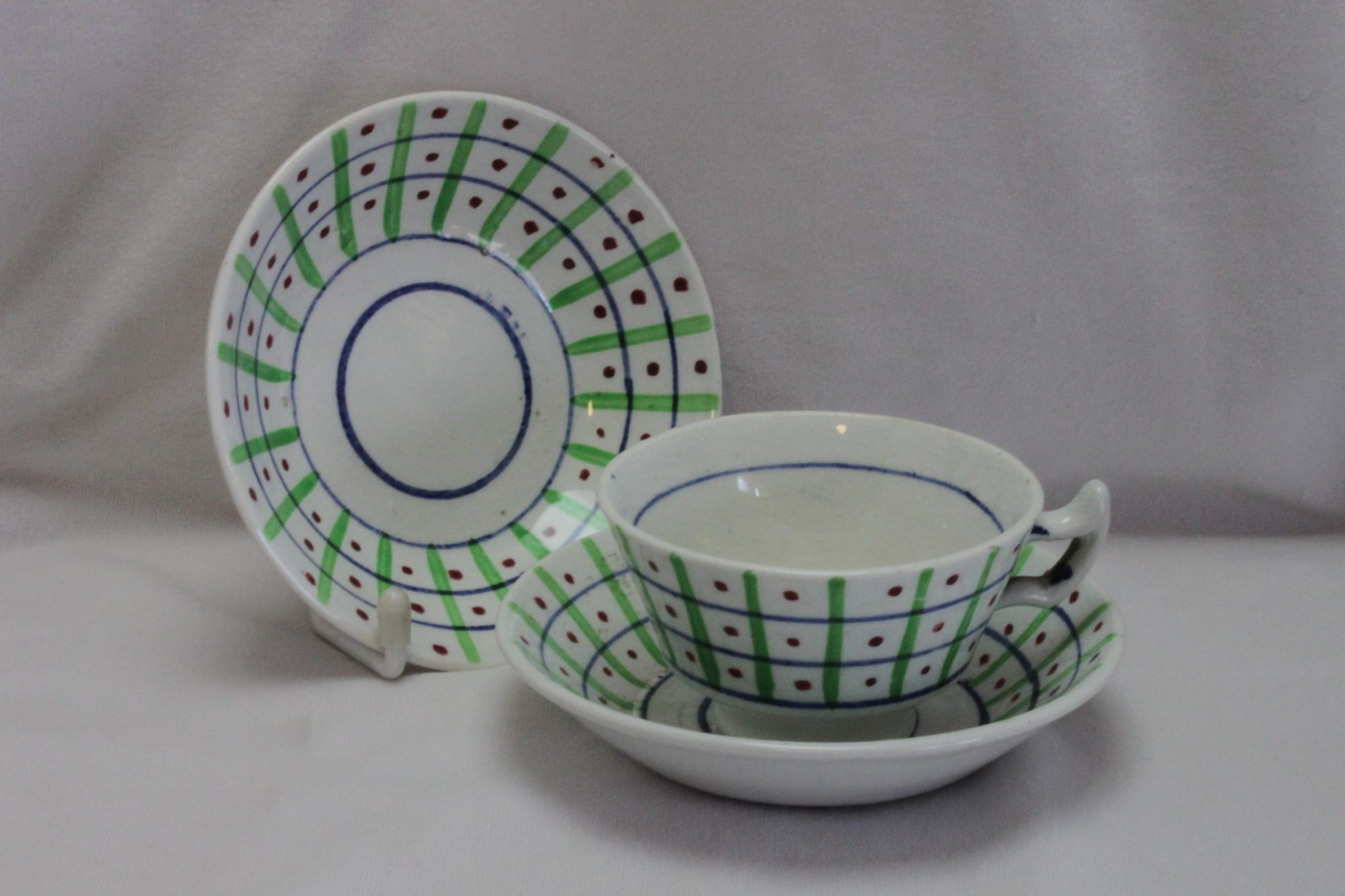 Hand painted cup and saucers from childs tea set c1820