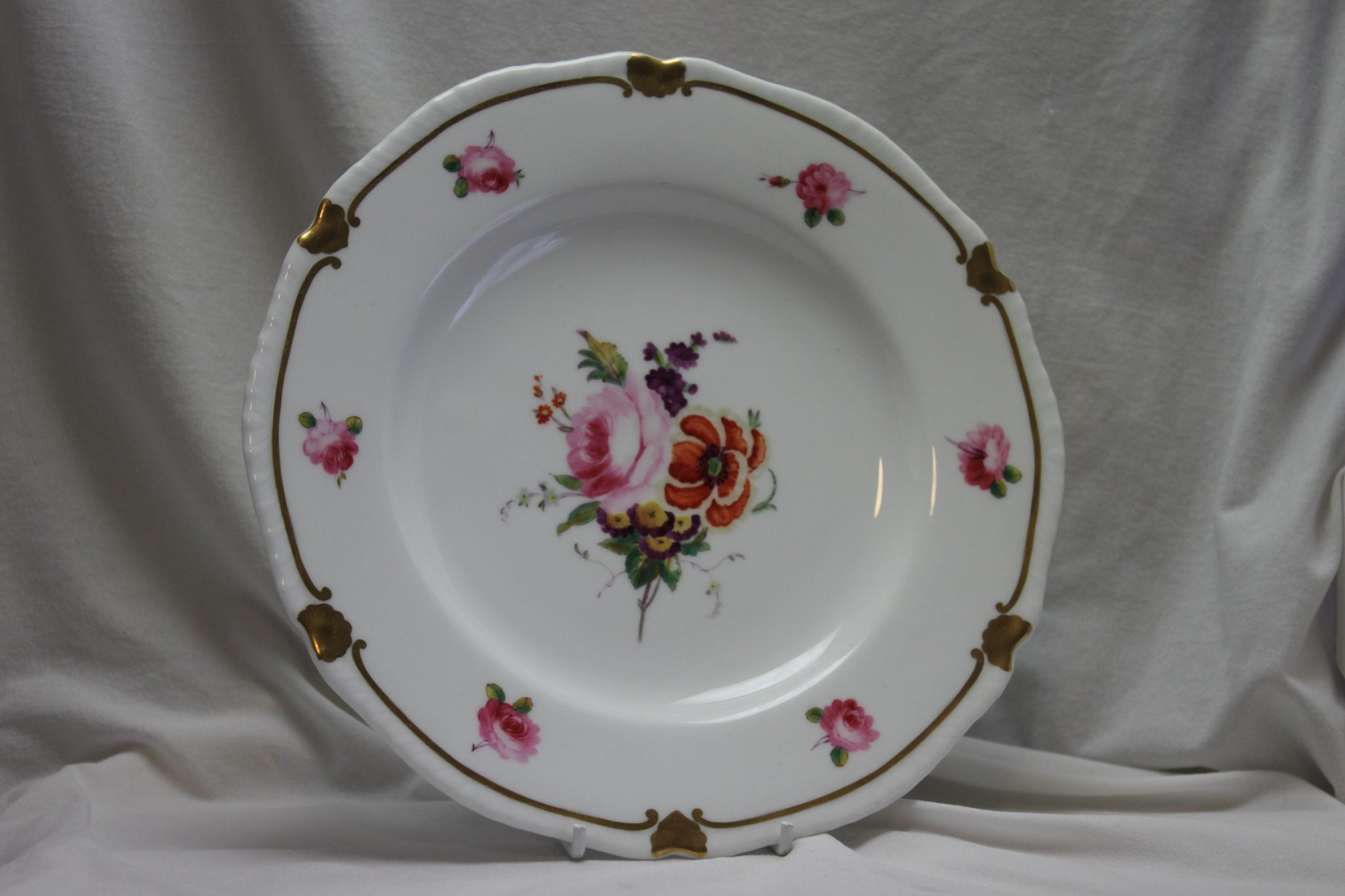 Minton hand painted and gilded plate