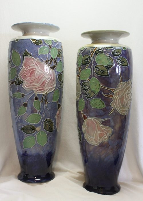 Pair of Royal Doulton tubelined stoneware vases