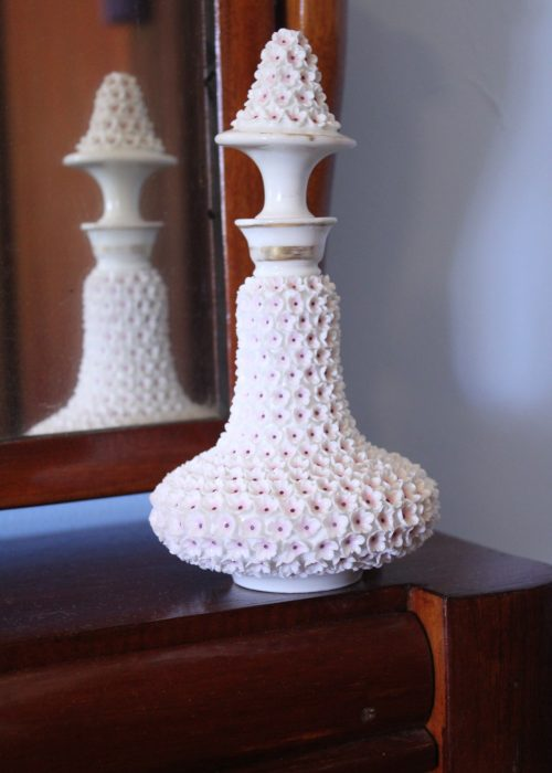 Flower encrusted porcelain scent bottle