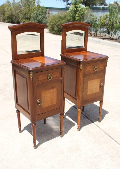 Pair of French inlaid bedside cabinets with mirrored backs