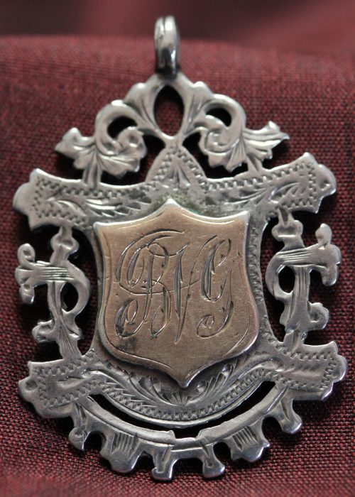 Sterling silver fob medal won by B V Grigg 1907