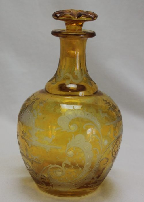 Engraved amber glass perfume bottle