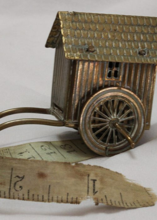 Brass novelty tape measure in the form of a Victorian bathing box