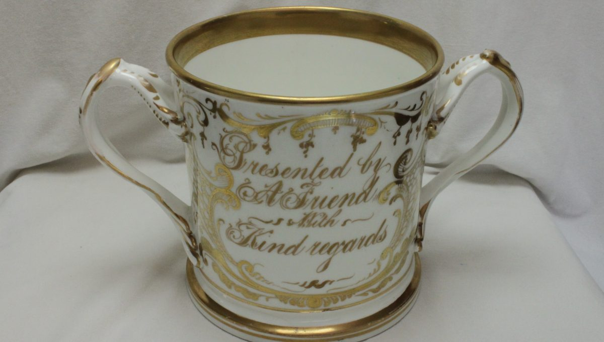 Large gilded loving cup possibly by Coalport