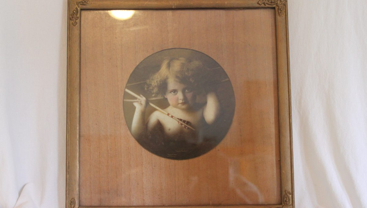 Cupid Awake and Cupid Asleep framed photographs
