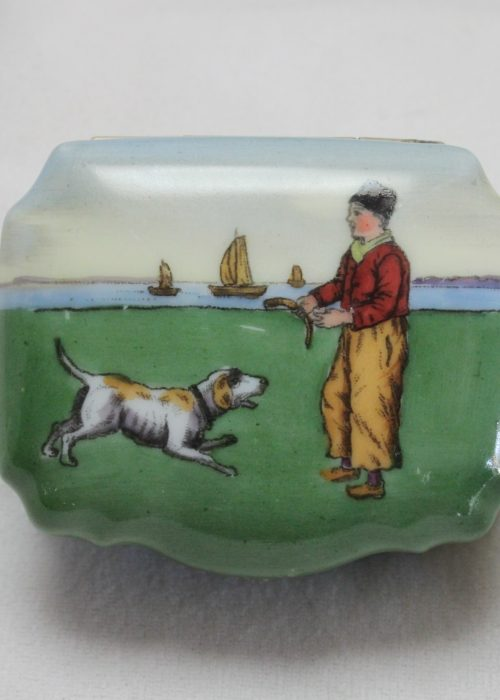 Hand coloured porcelain pill box with Dutch scene