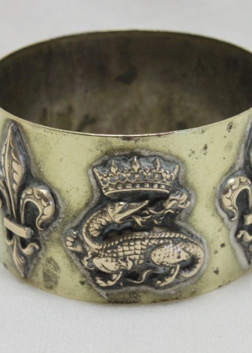 French brass napkin ring with applied royal emblems.